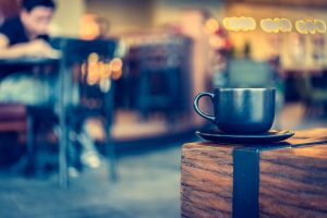 34528851 – coffee mug in coffee shop cafe – vintage effect style pictures